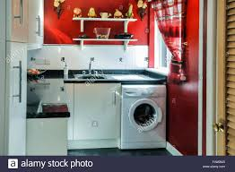 washing machine with sink washing machine and sink in a utility room of a house stock photo