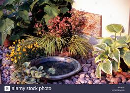 garden detail image of a bird bath surrounded by pebbles