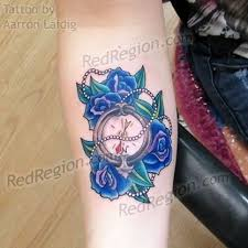 wisp style tattoo roses on ribs and back red region port angeles