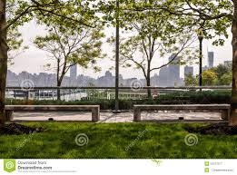park sitting area landscape with urban skyline background stock