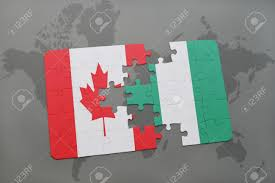 Nigeria On World Map by Puzzle With The National Flag Of Canada And Nigeria On A World