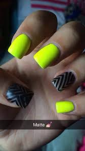 matte neon yellow nails with black design on bare nail cute and