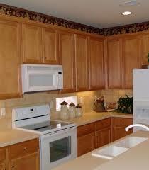 interior design oak kitchen cabinets with merola tile backsplash