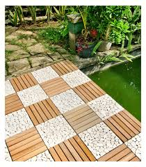 floor teak deck tiles with pool and stone footpath plus plants