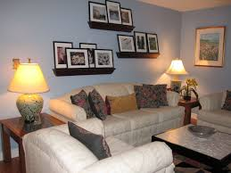 living room with wall shelves and cordless table lamps useful