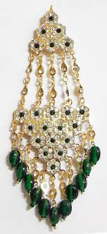left side earring jhoomar worn on the left side of the or as mang tika