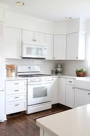 white kitchen with baseboard toe kick that matches hardwood