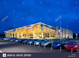 toyota car dealership toyota car showrooms at night time stock photo royalty free image