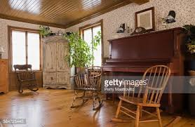 the livingroom rocking chairs and piano in the living room of house stock photo