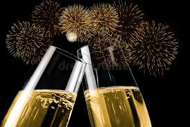 new years chagne flutes chagne flutes with golden bubbles make cheers with fireworks