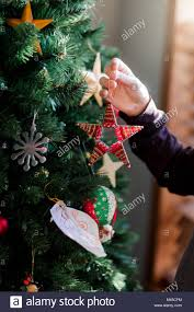 up christmas decorations putting up christmas decorations stock photos putting up