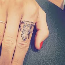 finger tattoos are the most fun and subtle ink trend we u0027re loving