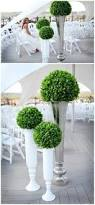 Topiaries Wedding - real weddings beth clint centerpieces branch centerpieces