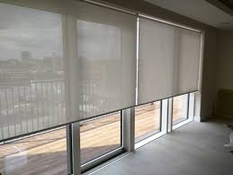 these roller blinds have been installed behind a pelmet to hide