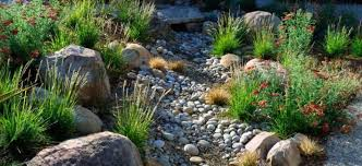 garden with boulders and river rock river rock landscaping ideas
