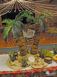 amiable abode pineapple palm tree centerpiece party layout