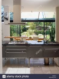 extractor fan over island unit in modern kitchen in spanish villa