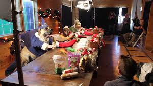 santa u0027s elves dogs and cats with human hands making toys