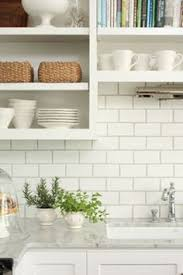 Kitchen Idea Of The Day Creamy Subway Tile Backsplash Behind The - Kitchen backsplash subway tile