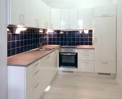 white kitchen with dark blue tiling video and photos
