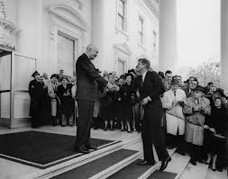 Kennedy Oval Office by President Eisenhower Greets President Elect Kennedy At The White