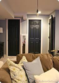 black trim black interior doors in the basement from thrifty decor