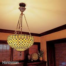 how to hang a heavy light fixture from the ceiling how to hang a ceiling light fixture the family handyman