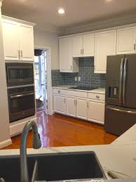 kitchen style dark gray subway glass tile kitchen backsplash dark gray subway glass tile kitchen backsplash white flat farmhouse cabinets black kitchen appliances stainless steel undermount kitchen sink