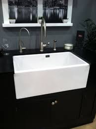 white sink black countertop home design apron sinks in modern kitchen with countertop and window