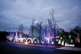 an outdoor holiday lighting display choreographed to music takes