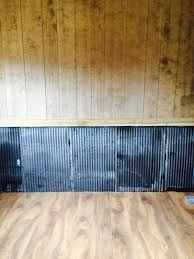 reclaimed tin on bottom half of wall it u0027s chair rail height it u0027s