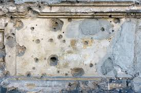 wall plaster texture with bullet holes stock photo image 91961429