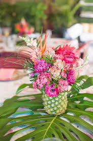 an elegant tropical bridal shower pineapple centerpiece