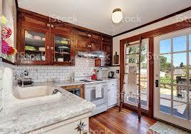 antique white usa kitchen cabinets vintage kitchen cabinets and white tile back splash trim stock photo image now