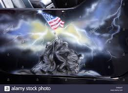 Painting A Flag Airbrush Painting On The Side Door Of A Jeep Illustrating The