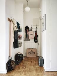 attractive entrance hall coat rack above large paper shopping bag