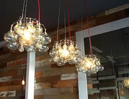 restaurant kitchen lighting chandeliers made from vintage canning racks handblown glass
