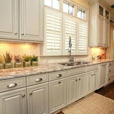 beige painted kitchen cabinets how do i paint kitchen cabinets beige painted cabinets with brushed