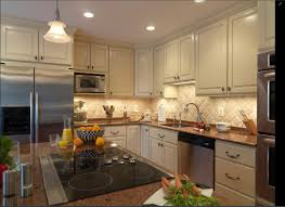 how to put up kitchen backsplash install molding on cabinets