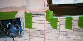 how to install a mosaic tile backsplash in the kitchen how to install a carrara marble mosaic tile backsplash part 1
