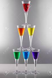 rainbow cocktail a row of drinks in rainbow colours stock photo picture and