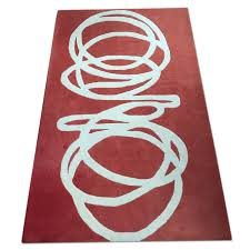 cb2 slink rug in red aptdeco