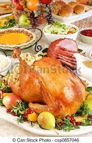 thanksgiving dinner with roast turkey baked ham pumpkin stock