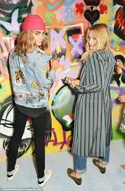 How To Graffiti With Spray Paint - cara delevingne and margot robbie get creative with spray paint at