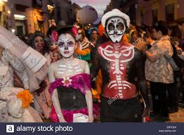 halloween costume mexican skeleton a mexican couple dressed in costumes parades through the streets