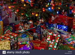 christmas presents and gifts under a christmas tree on christmas