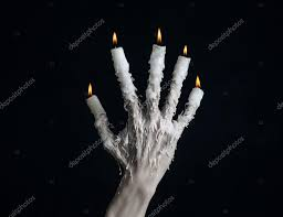 halloween black background image halloween theme on the hand wearing a candle and dripping melted