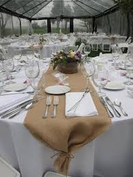 decorating awesome round table runner with white cover and tan