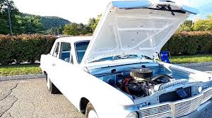 1965 metallic grayish blue bottom bone white top plymouth valient
