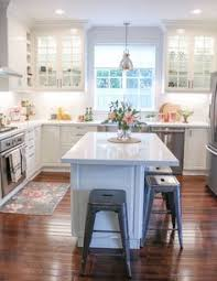 island designs for small kitchens gray kitchen features gray shaker cabinets adorned with brass